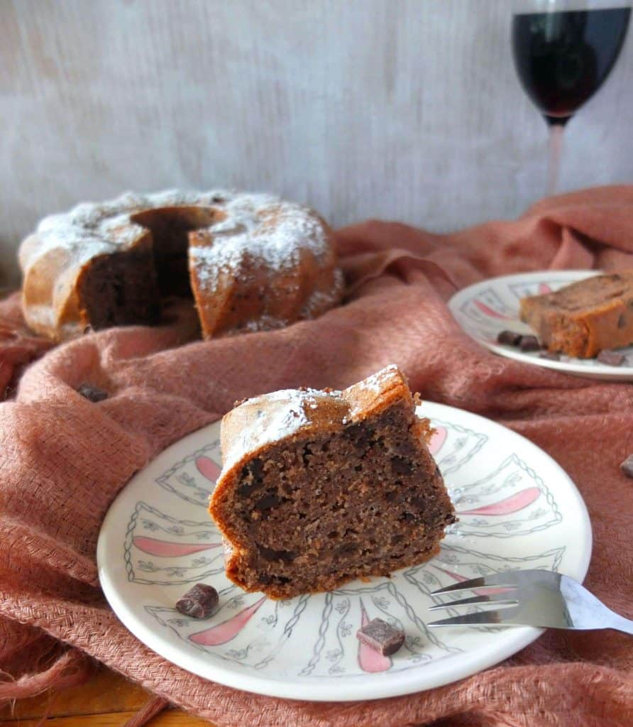 Red wine Chocolate cake with a glas of red wine in the background