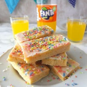 Fanta cake with fanta bottle and glasses in the background