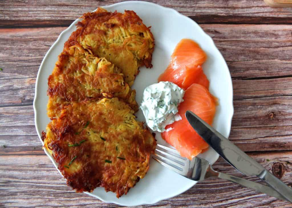 A plate with Kartoffelpuffer and quark dip and smoked salmon