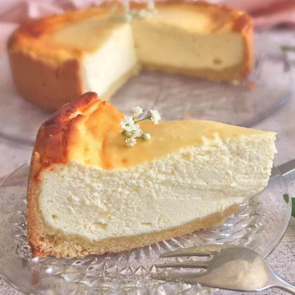 A slice of German cheesecake on a plate