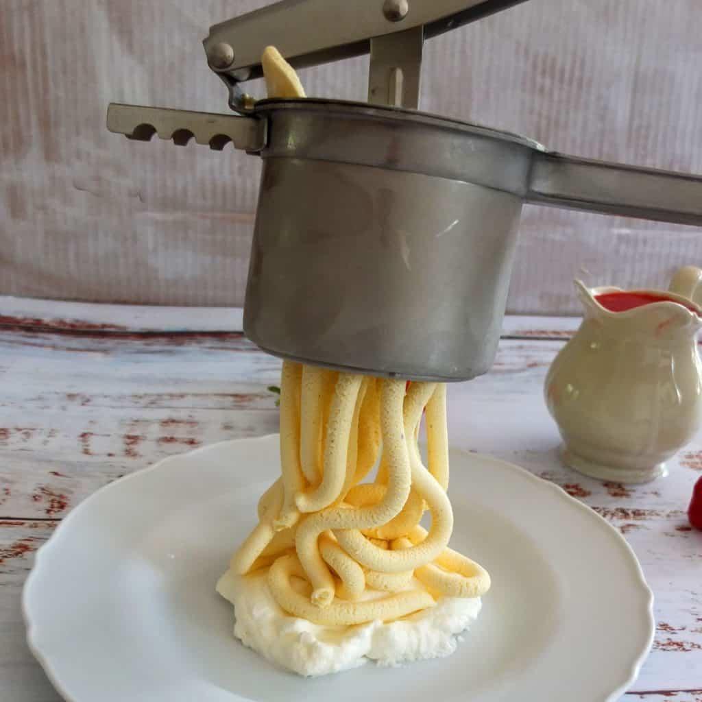 noddles shaped ice cream pressed through a spaetzle press